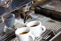 Espresso Machine. Close-up of two cups of fresh made espresso in a machine Stock Images