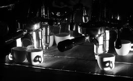 Espresso machine brewing a coffee. Black and white photo Royalty Free Stock Photos