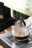 Espresso machine brewing a coffee Stock Image