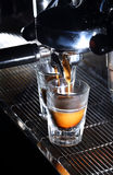 Espresso machine brewing a coffee. Coffee pouring into shot glass Stock Photography