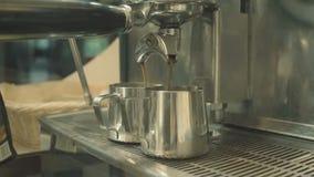 Espresso machine brews coffee stock footage
