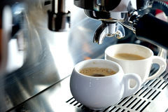 Espresso machine with coffee in white cups Royalty Free Stock Photos