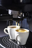 Espresso machine with cups of coffee Royalty Free Stock Photography