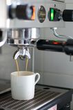 Espresso Machine Dripping Espresso into White Cup Royalty Free Stock Image