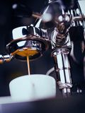 Espresso Machine Extracting Coffee and Dripping in White Cup stock photography
