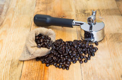 An espresso machine group head  and coffee beans in sacks Stock Photography