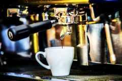 Espresso machine making special strong coffee in white glass royalty free stock images