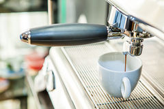 Espresso machine pouring coffee in cup Stock Photography