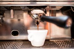 Espresso machine pouring coffee in pub, bar, restaurant Royalty Free Stock Images