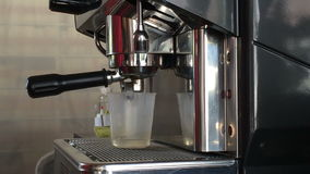 Espresso machine pouring espresso shot in cup-Dolly shot stock video footage