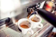 Espresso machine pouring fresh coffee into cups at restaurant. Coffee automatic machine making coffee Royalty Free Stock Photo