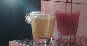 Espresso machine preparing a cup of coffee stock footage