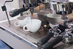 Espresso machine working with bar interior background Stock Images