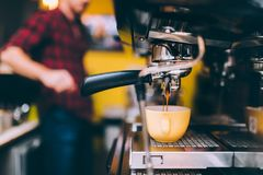 Espresso machinery pouring freshly brewed coffee in cafe shop. barista details and bartender Royalty Free Stock Photography