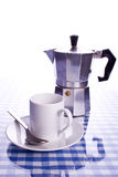 Espresso maker and cup. Espresso maker with cup and saucer reflected on glass surface Royalty Free Stock Images