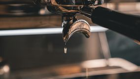 Espresso maker dripping after making a shot stock image
