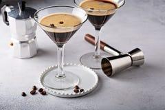 Espresso martini in two glasses. Coffee cocktail concept stock photography