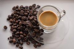 Espresso med kaffebönor 1 Arkivbild