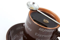 Espresso mug. Brown espresso mug with a white background Royalty Free Stock Photography