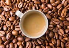 Espresso On Coffee Beans Stock Photos