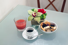 Espresso, pastries and juice Stock Photography