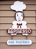 Espresso and Pastries sign. A wood sign shaped as a Baker advertising Espresso an Pastries Royalty Free Stock Photos