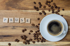 Espresso pause concept background on wood