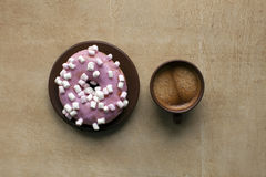 Espresso and pink donut on table. Coffee color texture Stock Image