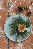 Espresso on plate with christmas wreath made from pine twigs on wooden table Royalty Free Stock Photo