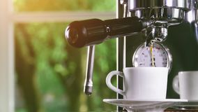 Espresso out of classic coffee machine into coffee cup stock video footage