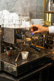 Espresso pouring from coffee machine Stock Photos
