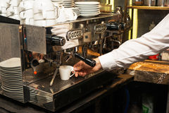 Espresso pouring from coffee machine Royalty Free Stock Image