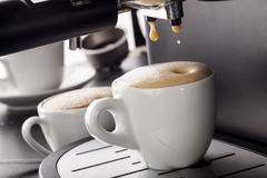 Espresso pouring from coffee machine. royalty free stock photo
