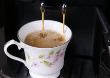 Espresso pouring into a cup Stock Image
