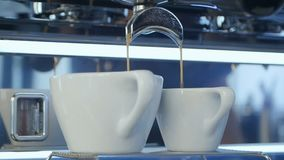 Espresso pouring into a cup. Close up. Slow motion. Professional shot in HD resolution. 091. You can use it e.g. in your commercial video, business stock video