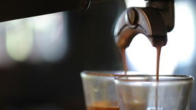 Espresso pouring to cup stock footage