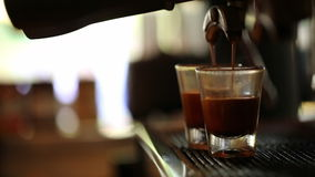 Espresso pouring to cup stock video footage