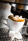 Espresso preparation. Gray coffee machine with white cup Stock Photography