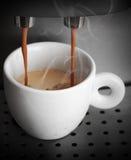 Espresso preparing, white cup in coffee machine Stock Photos
