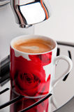 Espresso is ready. A cup of coffee on a espresso machine Stock Image