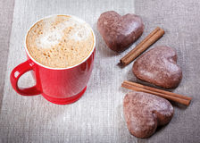 Espresso in a red circle, heart-shaped cookies, cinnamon on the Royalty Free Stock Image