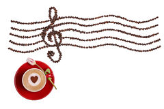 Espresso with red mug with a white-red tulips on white, background, heart, coffee beans, treble clef, musical outline.  Royalty Free Stock Image