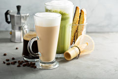 Espresso, regular coffee and matcha latte. On light background Stock Image