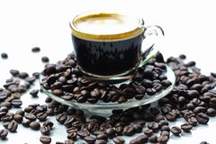 Espresso and roasted coffee on morning royalty free stock photography
