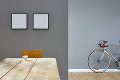 Espresso scene on wooden table in reduced vintage loft with bike Stock Images