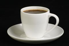 Espresso shot. Espresso coffee in white cup on a black background Royalty Free Stock Photos