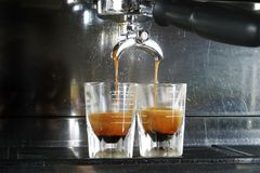 Espresso Shot. Espresso being drawn out of a professional espresso machine Stock Photo