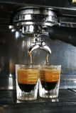 Espresso Shot. Espresso being drawn out of a professional espresso machine Royalty Free Stock Photo