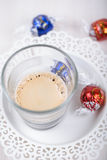 Espresso shot with chocolate candies.  stock image