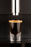 Espresso shot from exclusive coffee machine Royalty Free Stock Images